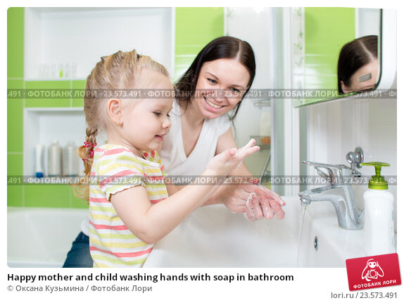 Купить «Happy mother and child washing hands with soap in bathroom», фото № 23573491, снято 2 апреля 2015 г. (c) Оксана Кузьмина / Фотобанк Лори