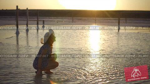 Купить «happy smiling girl enjoying sun, sprinkles salt water of lake in rays of sunset», видеоролик № 29407087, снято 3 ноября 2018 г. (c) Ирина Мойсеева / Фотобанк Лори