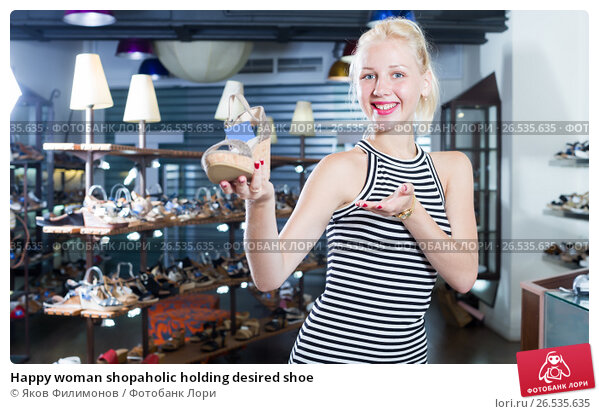 Купить «Happy woman shopaholic holding desired shoe», фото № 26535635, снято 21 апреля 2019 г. (c) Яков Филимонов / Фотобанк Лори