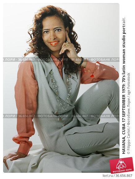 HAVANA, CUBA 17 SEPTEMBER 1979: 70's latin woman studio portrait. Редакционное фото, фотограф Filippo Carlot / age Fotostock / Фотобанк Лори