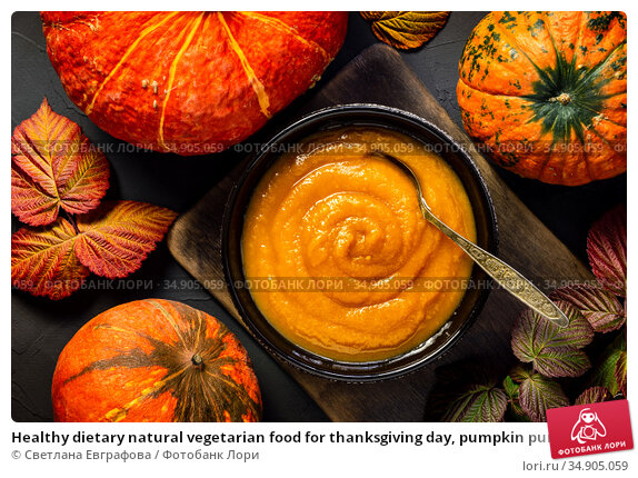 Healthy dietary natural vegetarian food for thanksgiving day, pumpkin puree soup, dessert jam, chutney, homemade vegetable caviar in a plate with fruits, autumn still life flatlay on black background. Стоковое фото, фотограф Светлана Евграфова / Фотобанк Лори