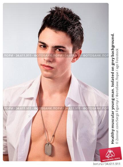 Healthy muscular young man. Isolated on grey background. Стоковое фото, фотограф Zoonar.com/Sergii Figurnyi / age Fotostock / Фотобанк Лори