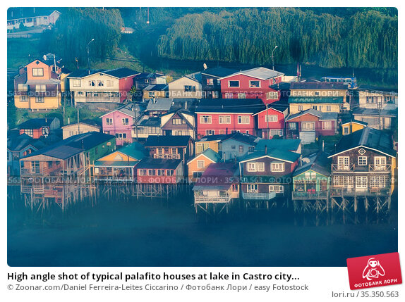High angle shot of typical palafito houses at lake in Castro city... Стоковое фото, фотограф Zoonar.com/Daniel Ferreira-Leites Ciccarino / easy Fotostock / Фотобанк Лори
