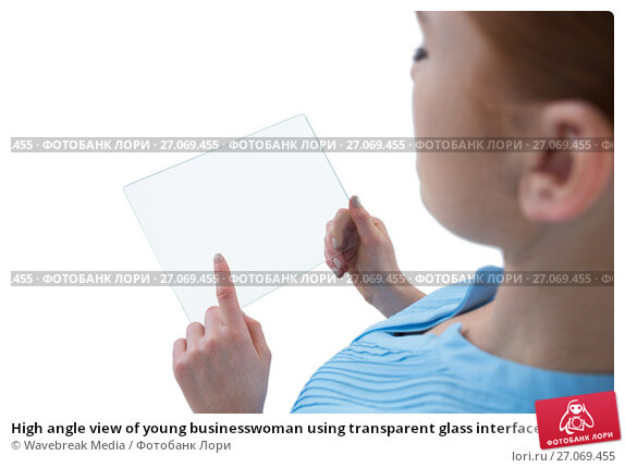 High angle view of young businesswoman using transparent glass interface, фото № 27069455, снято 6 июня 2017 г. (c) Wavebreak Media / Фотобанк Лори