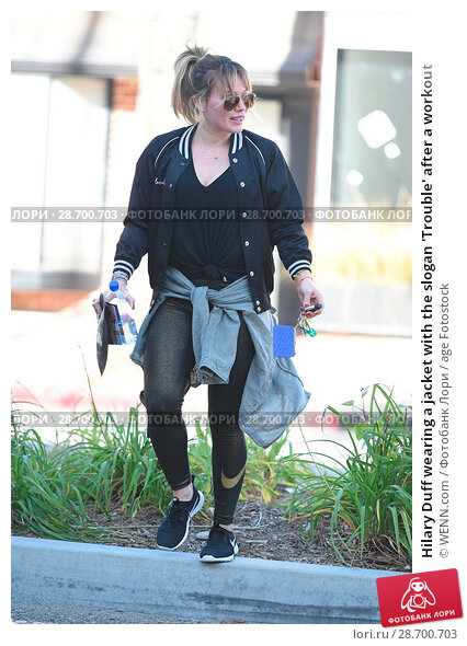 Купить «Hilary Duff wearing a jacket with the slogan 'Trouble' after a workout Featuring: Hilary Duff Where: Los Angeles, California, United States When: 28 Dec 2016 Credit: WENN.com», фото № 28700703, снято 28 декабря 2016 г. (c) age Fotostock / Фотобанк Лори
