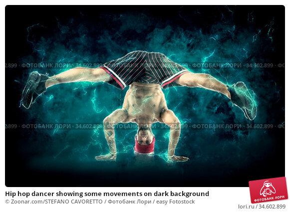 Hip hop dancer showing some movements on dark background. Стоковое фото, фотограф Zoonar.com/STEFANO CAVORETTO / easy Fotostock / Фотобанк Лори