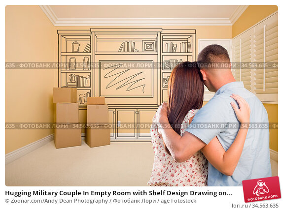 Hugging Military Couple In Empty Room with Shelf Design Drawing on... Стоковое фото, фотограф Zoonar.com/Andy Dean Photography / age Fotostock / Фотобанк Лори