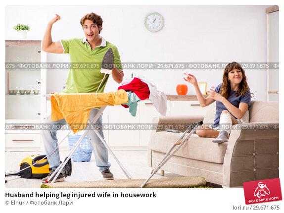 Купить «Husband helping leg injured wife in housework», фото № 29671675, снято 4 октября 2018 г. (c) Elnur / Фотобанк Лори