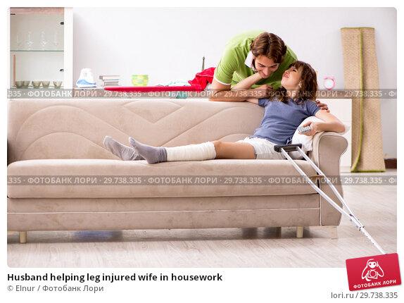 Купить «Husband helping leg injured wife in housework», фото № 29738335, снято 4 октября 2018 г. (c) Elnur / Фотобанк Лори