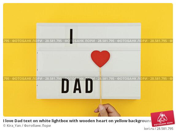 Купить «I love Dad text on white lightbox with wooden heart on yellow background», фото № 28581795, снято 11 июня 2018 г. (c) Kira_Yan / Фотобанк Лори
