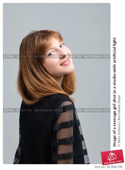 Image of a teenage girl shot in a studio with artificial light. Стоковое фото, фотограф Miru misiura / Фотобанк Лори