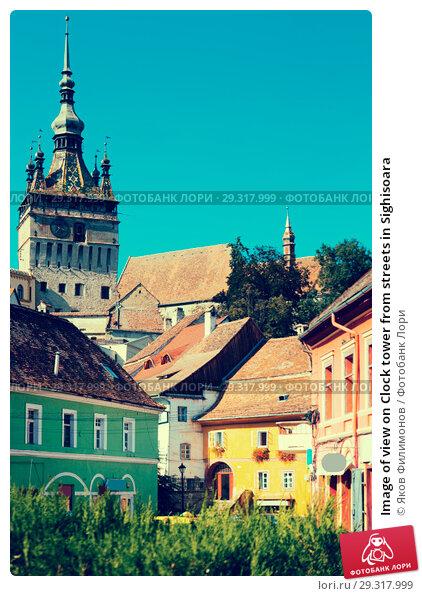 Купить «Image of view on Clock tower from streets in Sighisoara», фото № 29317999, снято 16 сентября 2017 г. (c) Яков Филимонов / Фотобанк Лори