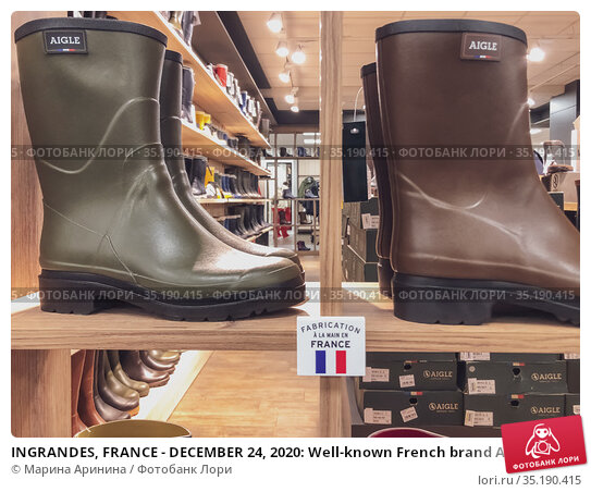 INGRANDES, FRANCE - DECEMBER 24, 2020: Well-known French brand AIGLE rubber boots in the store. Редакционное фото, фотограф Ирина Аринина / Фотобанк Лори