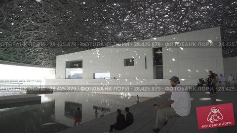 Купить «Interior of the new Louvre Museum in Abu Dhabi showing reflections of the Rain of Light dome stock footage video», видеоролик № 28425879, снято 4 апреля 2018 г. (c) Юлия Машкова / Фотобанк Лори