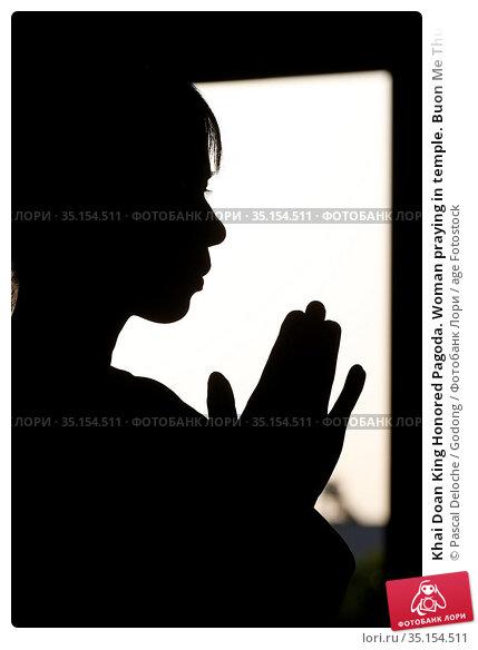 Khai Doan King Honored Pagoda. Woman praying in temple. Buon Me Thuot... Стоковое фото, фотограф Pascal Deloche / Godong / age Fotostock / Фотобанк Лори