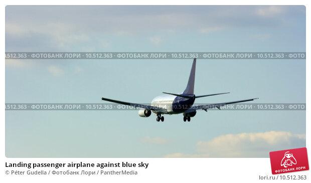 Купить «Landing passenger airplane against blue sky», фото № 10512363, снято 19 марта 2019 г. (c) PantherMedia / Фотобанк Лори