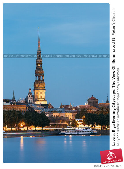 Купить «Latvia, Riga Evening Cityscape. The View Of Illuminated St. Peter's Church Tower Behind Daugava River Quay, Old Town In Summer Dusk Under Blue Sky.», фото № 28700075, снято 30 июня 2016 г. (c) easy Fotostock / Фотобанк Лори