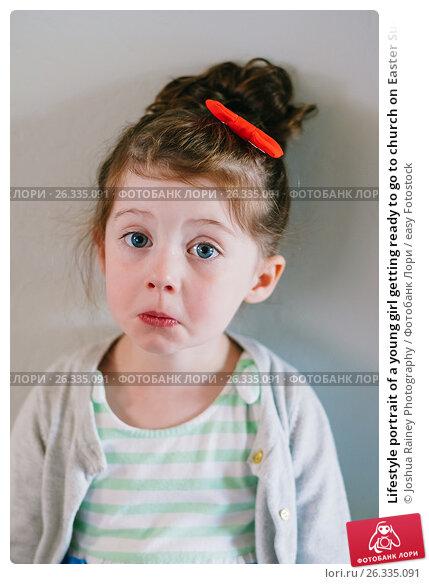 Lifestyle portrait of a young girl getting ready to go to church on Easter Sunday., фото № 26335091, снято 15 апреля 2017 г. (c) easy Fotostock / Фотобанк Лори