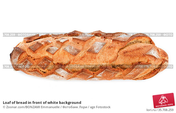 Loaf of bread in front of white background. Стоковое фото, фотограф Zoonar.com/BONZAMI Emmanuelle / age Fotostock / Фотобанк Лори