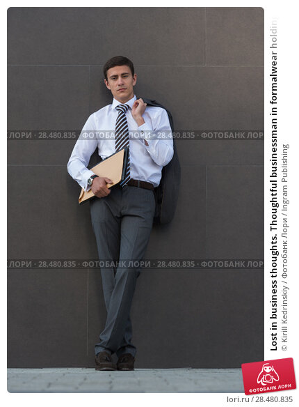 Купить «Lost in business thoughts. Thoughtful businessman in formalwear holding documents and looking away while standing against grey wall background», фото № 28480835, снято 20 июля 2014 г. (c) Ingram Publishing / Фотобанк Лори