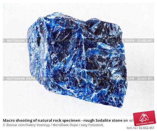 Macro shooting of natural rock specimen - rough Sodalite stone on white marble background. Стоковое фото, фотограф Zoonar.com/Valery Voennyy / easy Fotostock / Фотобанк Лори