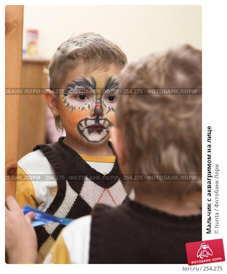 Мальчик с аквагримом на лице, фото № 254275, снято 1 января 2008 г. (c) hunta / Фотобанк Лори