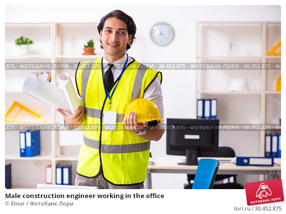 Male construction engineer working in the office. Стоковое фото, фотограф Elnur / Фотобанк Лори