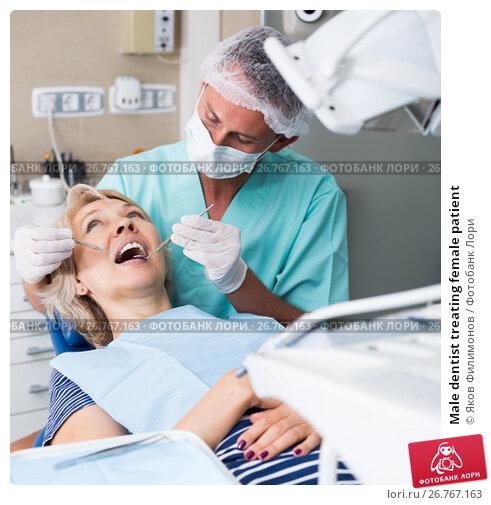 Male dentist treating female patient, фото № 26767163, снято 5 июля 2017 г. (c) Яков Филимонов / Фотобанк Лори