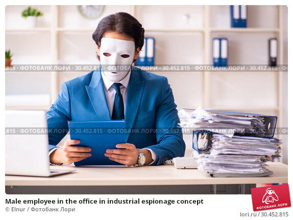 Male employee in the office in industrial espionage concept. Стоковое фото, фотограф Elnur / Фотобанк Лори