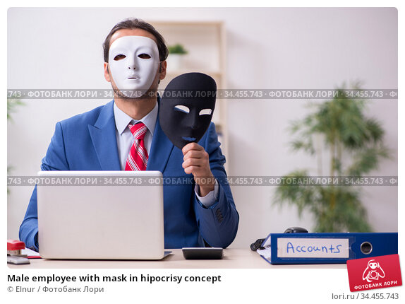 Male employee with mask in hipocrisy concept. Стоковое фото, фотограф Elnur / Фотобанк Лори