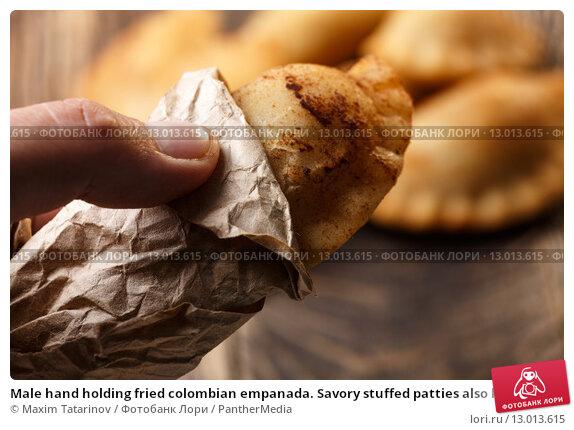 Купить «Male hand holding fried colombian empanada. Savory stuffed patties also known as pastel,pate or pirozhki», фото № 13013615, снято 20 мая 2019 г. (c) PantherMedia / Фотобанк Лори