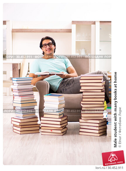 Male student with many books at home. Стоковое фото, фотограф Elnur / Фотобанк Лори