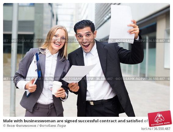 Male with businesswoman are signed successful contract and satisfied of it. Стоковое фото, фотограф Яков Филимонов / Фотобанк Лори