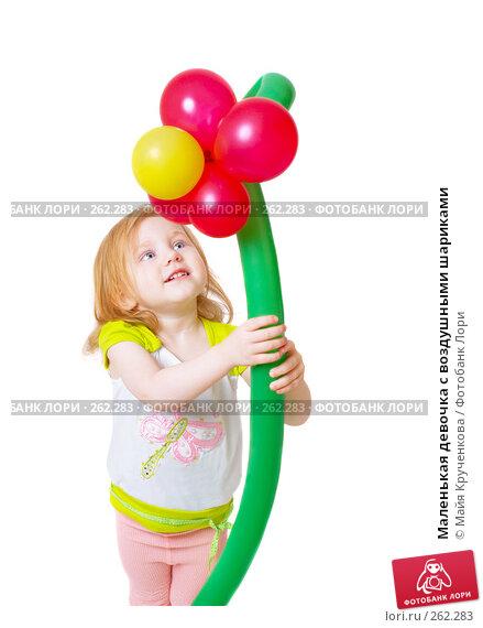 Маленькая девочка с воздушными шариками, фото № 262283, снято 24 апреля 2008 г. (c) Майя Крученкова / Фотобанк Лори