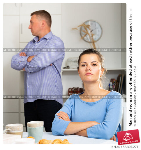 Man and woman are offended at each other because of the misunderstanding in his home. Стоковое фото, фотограф Яков Филимонов / Фотобанк Лори