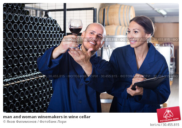 man and woman winemakers in wine cellar. Стоковое фото, фотограф Яков Филимонов / Фотобанк Лори