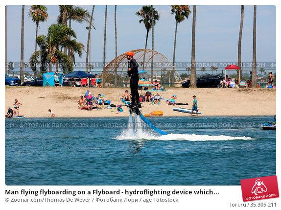 Man flying flyboarding on a Flyboard - hydroflighting device which... Стоковое фото, фотограф Zoonar.com/Thomas De Wever / age Fotostock / Фотобанк Лори