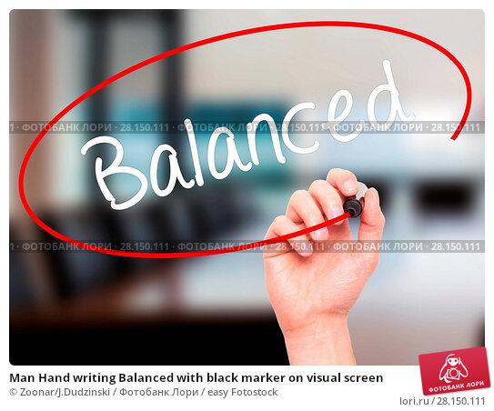 Купить «Man Hand writing Balanced with black marker on visual screen», фото № 28150111, снято 20 июня 2018 г. (c) easy Fotostock / Фотобанк Лори