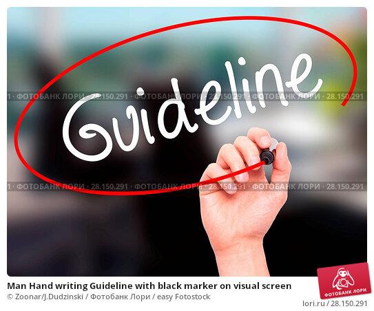 Купить «Man Hand writing Guideline with black marker on visual screen», фото № 28150291, снято 20 июня 2018 г. (c) easy Fotostock / Фотобанк Лори