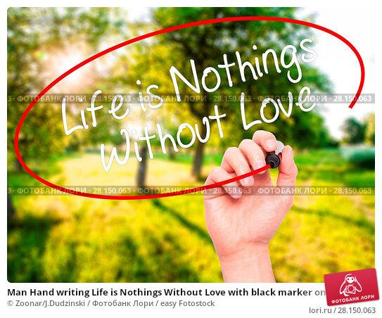 Купить «Man Hand writing Life is Nothings Without Love with black marker on visual screen», фото № 28150063, снято 18 июня 2018 г. (c) easy Fotostock / Фотобанк Лори