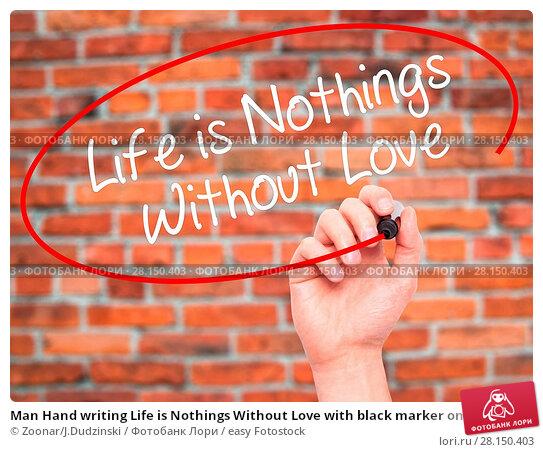 Купить «Man Hand writing Life is Nothings Without Love with black marker on visual screen», фото № 28150403, снято 21 июня 2018 г. (c) easy Fotostock / Фотобанк Лори