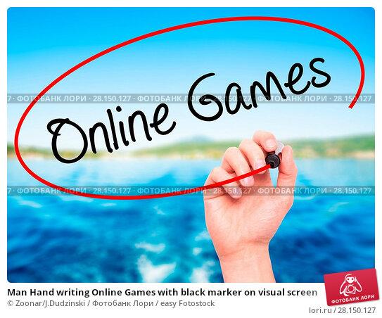 Купить «Man Hand writing Online Games with black marker on visual screen», фото № 28150127, снято 22 июня 2018 г. (c) easy Fotostock / Фотобанк Лори