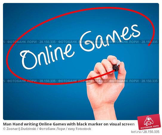 Купить «Man Hand writing Online Games with black marker on visual screen», фото № 28150335, снято 21 июня 2018 г. (c) easy Fotostock / Фотобанк Лори