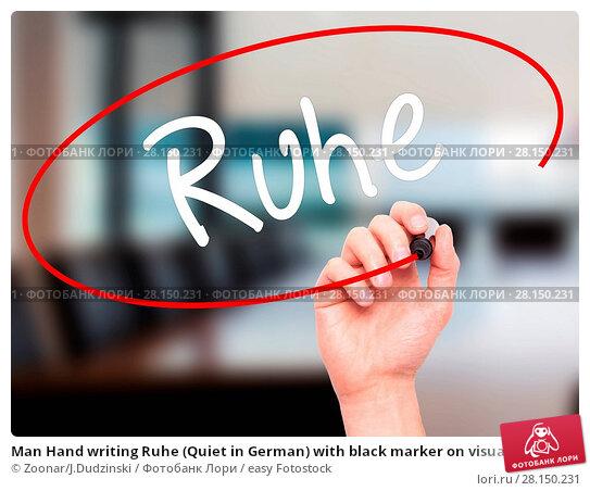 Купить «Man Hand writing Ruhe (Quiet in German) with black marker on visual screen», фото № 28150231, снято 21 июня 2018 г. (c) easy Fotostock / Фотобанк Лори