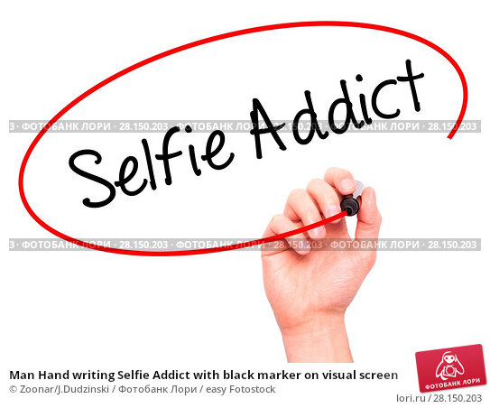 Купить «Man Hand writing Selfie Addict with black marker on visual screen», фото № 28150203, снято 21 июня 2018 г. (c) easy Fotostock / Фотобанк Лори