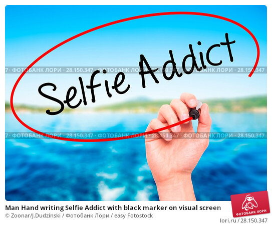 Купить «Man Hand writing Selfie Addict with black marker on visual screen», фото № 28150347, снято 18 июня 2018 г. (c) easy Fotostock / Фотобанк Лори