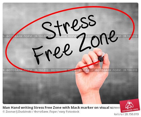 Купить «Man Hand writing Stress Free Zone with black marker on visual screen», фото № 28150019, снято 18 июня 2018 г. (c) easy Fotostock / Фотобанк Лори