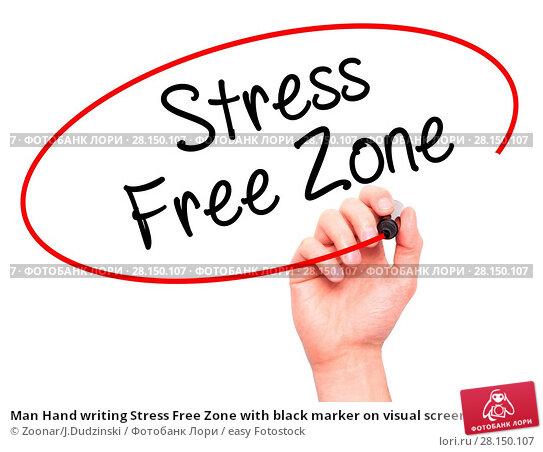 Купить «Man Hand writing Stress Free Zone with black marker on visual screen», фото № 28150107, снято 18 июня 2018 г. (c) easy Fotostock / Фотобанк Лори