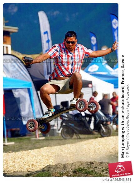 Купить «Man jumping with an e-skateboard, France, Savoie», фото № 26543851, снято 2 ноября 2015 г. (c) age Fotostock / Фотобанк Лори