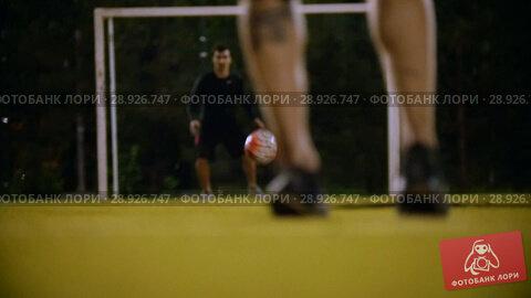 Купить «Man kicked the ball, the goalkeeper caught him», видеоролик № 28926747, снято 21 августа 2018 г. (c) Константин Шишкин / Фотобанк Лори